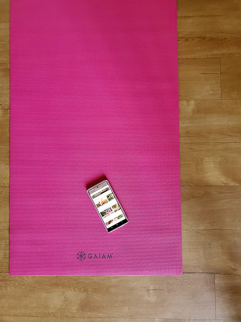 A yoga mat and a phone for morning routine.